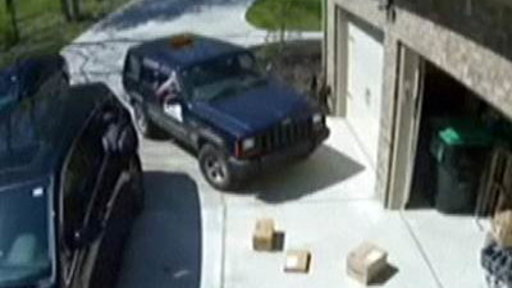 Postal Worker Tosses $400 Package Out of Car