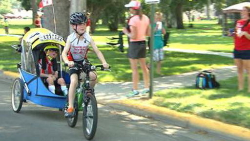 Boy, 8, Does Triathlon With Disabled Brother, 6