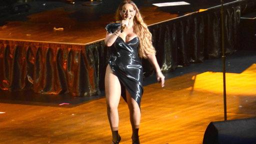 Mariah Carey Performs Wearing Very High-cut Dress