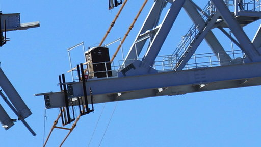 Would You Use a Port a Potty Perched On a Crane?